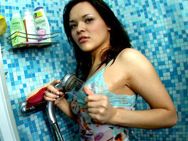 Busty brunette teenage angel Abigail washing her awesome body in the shower