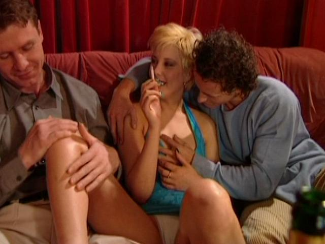 Short haired european chick getting humped by two horny guys on the couch