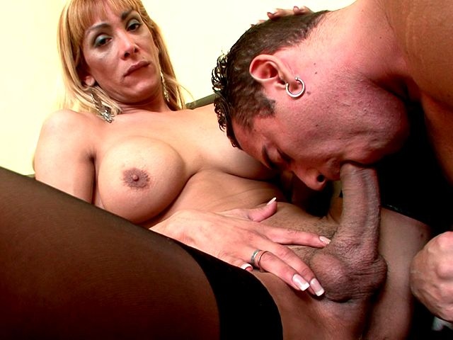 Winsome stockinged blonde shemale cheerleader Celeste gets giant dick sucked by a hot stud