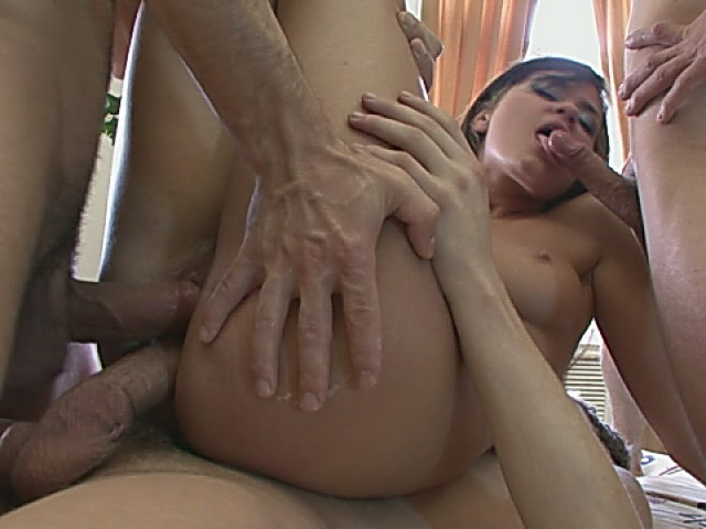 Passionate brunette whore getting double penetrated on the couch
